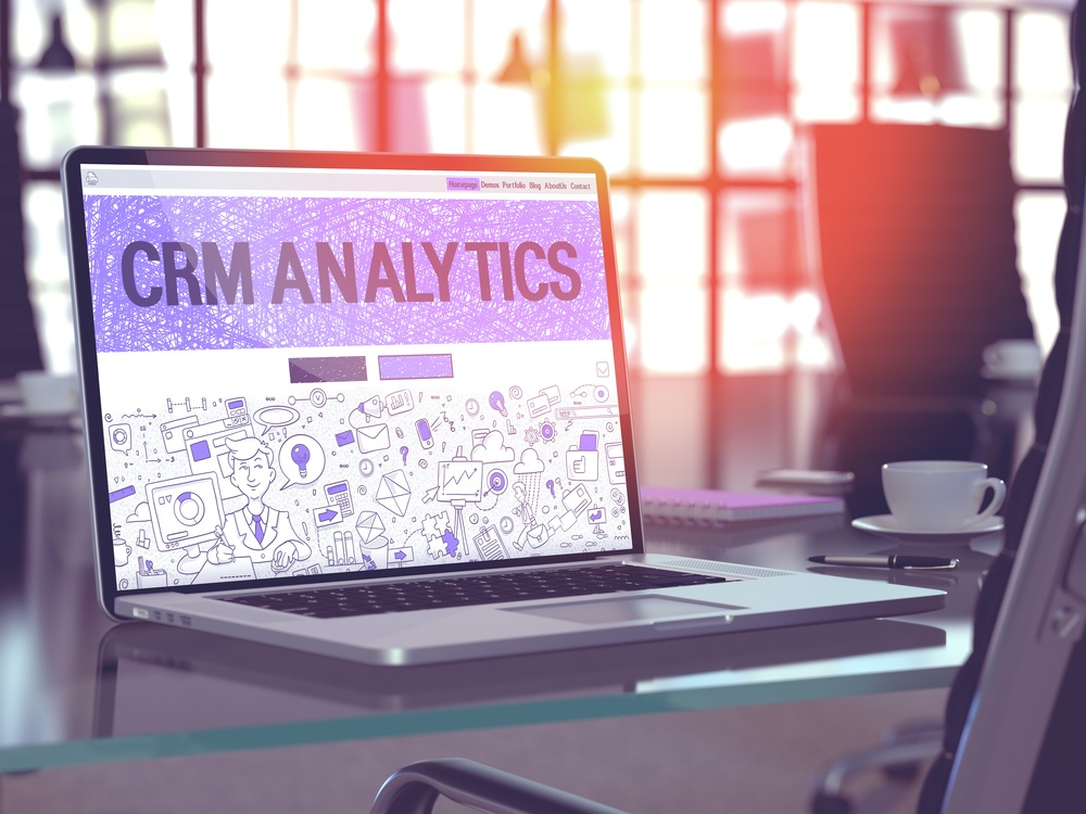 CRM Analytics - Closeup Landing Page in Doodle Design Style on Laptop Screen. On Background of Comfortable Working Place in Modern Office. Toned, Blurred Image. 3D Render.